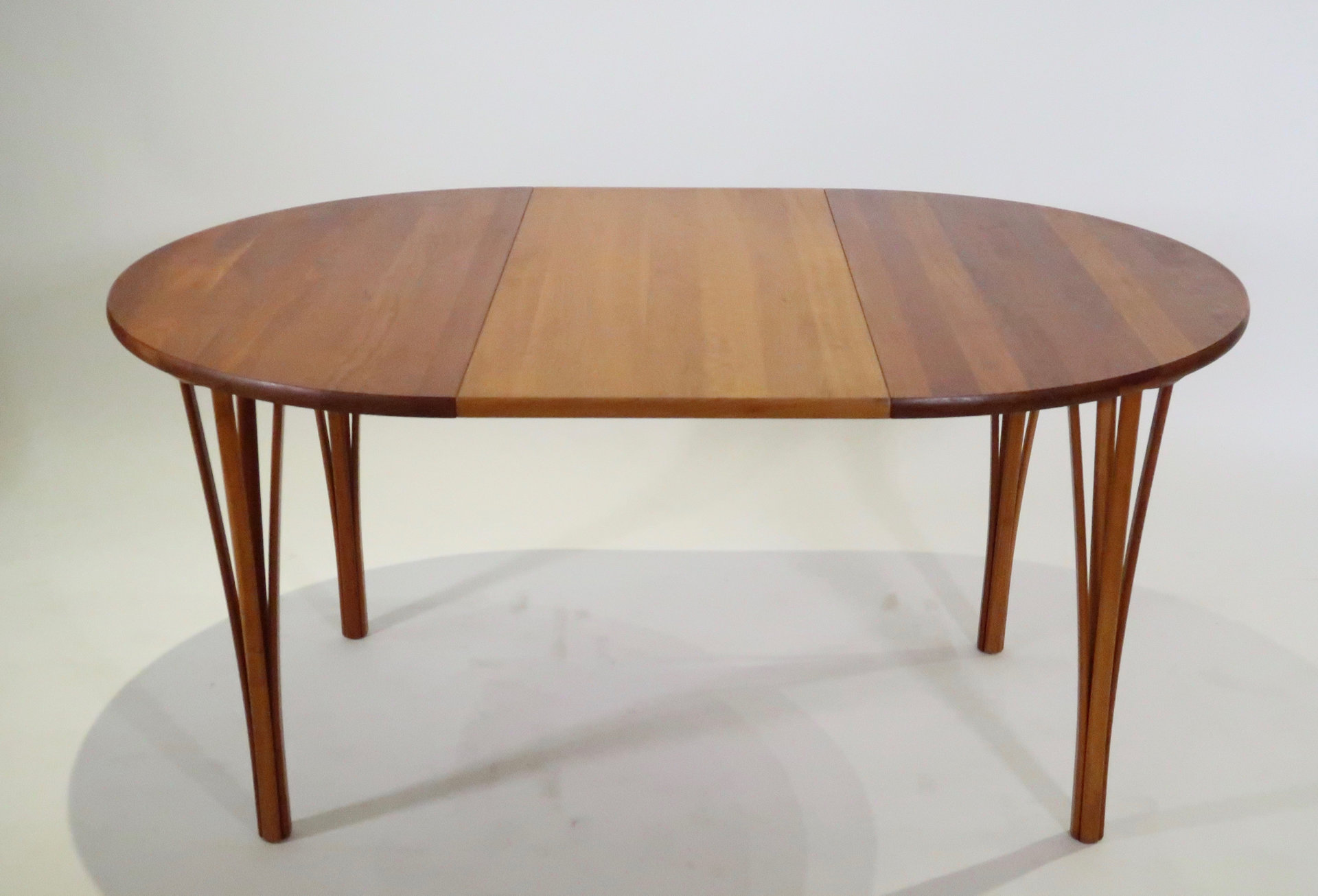 Table scandinave ronde en teck avec allonge
